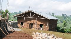 can help support construction of a hall for children's catechism, Bible study and other activities.